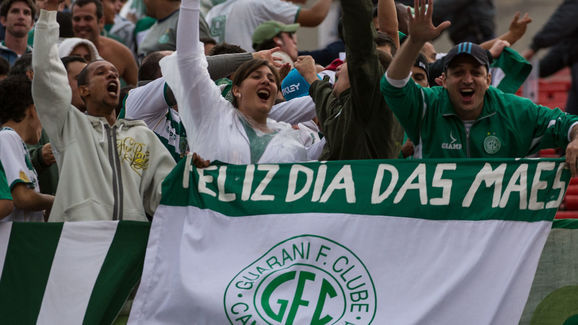 Supporters of Guarani holding a banner r