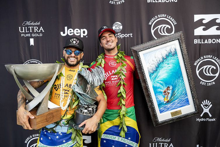 OAHU, UNITED STATES - DECEMBER 19: (L-R) Italo Ferreira of Brazil winner of his maiden WSL World Title and his maiden 2019 Billabong Pipe Masters and Two-time WSL Champion Gabriel Medina of Brazil runner-up at Pipeline on December 19, 2019 in