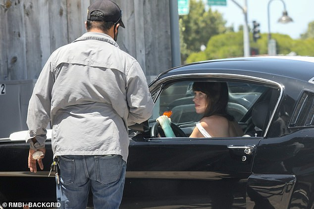 Break down:Dakota Johnson suffered an unfortunate mishap on Saturday after her vintage Mustang broke down while out out shopping with boyfriend Chris Martin